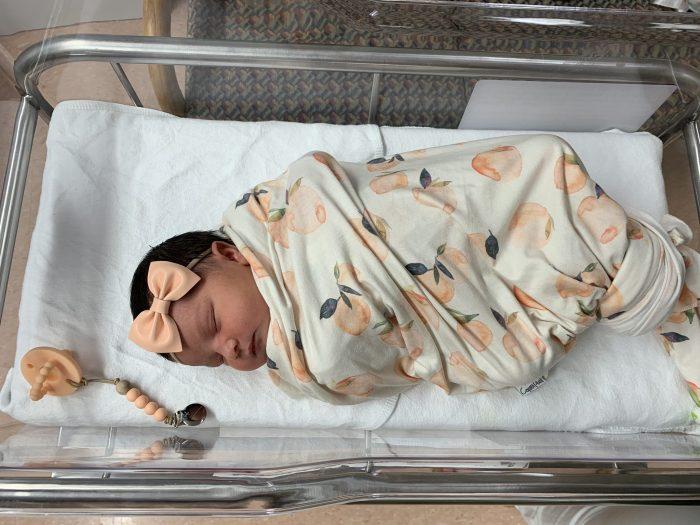 Baby girl sleeping in hospital crib